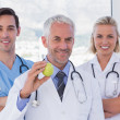 Group of doctor and nurses standing — Stock Photo