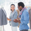 Fashion designers adjusting blazer — Stock Photo