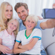 Family taking pictures — Stock Photo #26983603