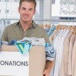 Handsome man holding donation box — Stock Photo #26983887