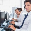 Stock Photo: Portrait of smiling call center employee
