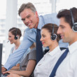 Call centre working with headset — Stock Photo