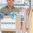 Volunteer holding donation box — Stock Photo