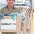 Volunteer holding donation box — Stock Photo #26984119