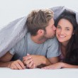 Handsome man kissing his wife — Stock Photo