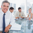 Stock Photo: Smiling businessman in a meeting