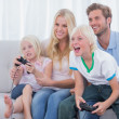 Family playing video games — Stock Photo #26985615