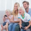Family playing video games — Stock Photo