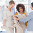 Fashion designers looking at a blazer — Stock Photo #26985623