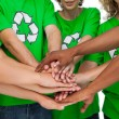 Group of environmental activists putting hands together — Stock Photo