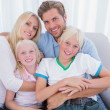Family smiling at camera — Stock Photo