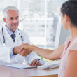 Doctor shaking hands to patient — Stock Photo #26986237