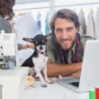 Smiling fashion designer with his chihuahua — Stock Photo