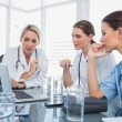 Three women doctors watching a laptop — Stock Photo