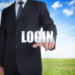 Stock Photo: Businessmselecting login word