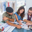 Three fashion designers working in a bright office — Stock Photo #26986353