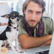 Fashion designer with his chihuahua — Stock Photo