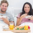 Stock Photo: Couple eating cereal during a romantic breakfast
