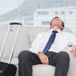 Exhausted businessman sleeping — Stockfoto