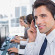 Stock Photo: Portrait of confident call center agent