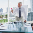 Boss gesturing in front of colleagues — Stock Photo