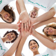 Stock Photo: Cheerful group of volunteers putting hands together