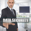 Stock Photo: Businessmtouching term datsecurity