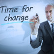 Businessmwriting time for change — Stock Photo #26988555