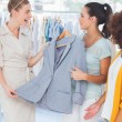 Smiling women holding a blazer — Stock Photo #26988979