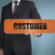 Businessman touching the word customer — Stock Photo