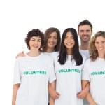 Smiling group of volunteers standing — Stock Photo