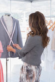 Fashion designer measuring blazer lapel — Stock Photo