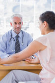 Female patient explaining her painful to doctor — Stock Photo
