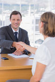 Businessman giving a handshake to a job applicant — Stock Photo