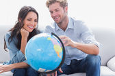 Couple looking at a globe — Stock Photo