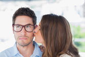 Attractive designer giving a kiss to a colleague — Stock Photo