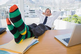 Businessman having a nap with feet on the desk — Stock Photo