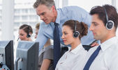 Manager helping call centre agent — Stock Photo