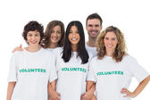 Group of wearing volunteer tshirt — Stock Photo