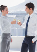 Business clinking their flutes of champagne — Stock Photo