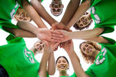 Smiling group of activists piling up their hands — Stock Photo