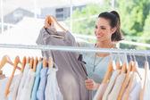 Fashion woman choosing dress — Stock Photo