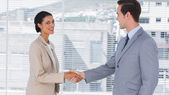 Businesswoman shaking hands to businessman — Stock Photo