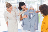 Attractive women looking at blazer — Stock Photo