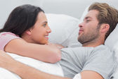 Couple awaking and looking at each other — Stock Photo
