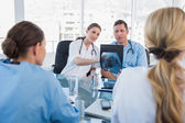 Medical team analysing a x-ray — Stock Photo