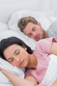 Peaceful couple sleeping in bed — Stock Photo