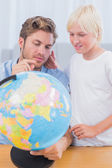 Father and his son looking at globe — Stock Photo