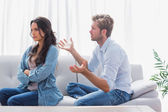 Woman sulking while her partner is talking to her — Stock Photo