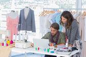 Two fashion designers working on laptop — Stock Photo